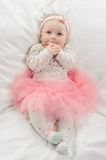 Baby girl in pink Stock Images