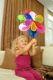 Baby girl with pinwheel Stock Photos
