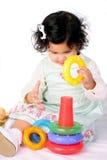 Baby girl with piramyd. Baby-girl building piramyd on white Stock Photo