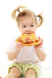 Baby girl with pizza Stock Image