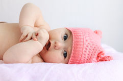 Baby girl plaing with her small hands Royalty Free Stock Photos