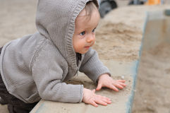 Baby girl plaing on the playground Royalty Free Stock Photos
