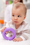 Baby girl with plastic toy Stock Images