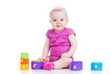 Baby girl play cup toys Royalty Free Stock Photo
