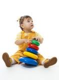 Baby girl play with pyramid Stock Photos