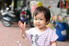 Baby girl play soap bubble Royalty Free Stock Photo