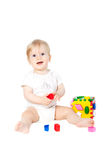Baby girl played with a toy Royalty Free Stock Photo