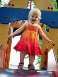 Baby girl on a playground. Royalty Free Stock Images