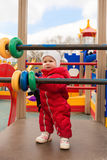 Baby girl on playground outdoors stock photo
