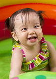 Baby girl playin in water royalty free stock photo