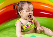 Baby girl playin in water Stock Photography