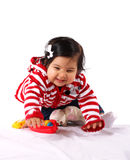 Baby girl playing Royalty Free Stock Image