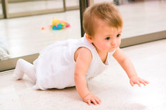 Baby girl playing Stock Photography