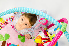 Baby girl playing in an activity gym Stock Photography
