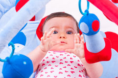 Baby girl playing with baby toys gym. Royalty Free Stock Photo