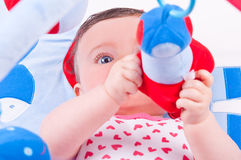 Baby girl playing with baby toys gym. Stock Image