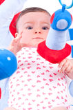 Baby girl playing with baby toys gym. Stock Photography