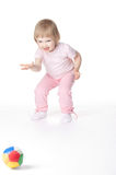 Baby girl is playing with ball Royalty Free Stock Photography