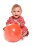 Baby girl playing with a ball. Cutout Stock Image