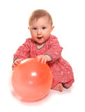 Baby girl playing with a ball. Cutout Royalty Free Stock Image