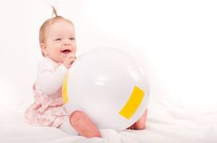 Baby girl playing with ball Royalty Free Stock Images
