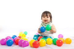 Baby girl is playing ball Royalty Free Stock Photos