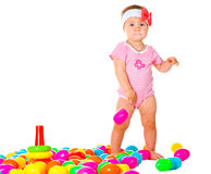 Baby girl playing in the balls Stock Photo
