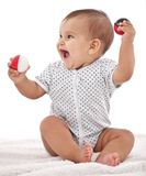 Baby girl playing with balls. Stock Images