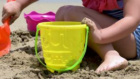 Closeup of a girl building castles in the sand stock video