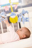 Baby girl playing in bed Stock Image