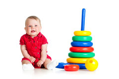 Baby girl playing with big toy Royalty Free Stock Image