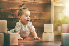 Baby girl playing with blocks Stock Image
