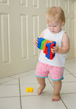 Baby girl playing with blocks. Baby / toddler girl playing with colourful blocks Royalty Free Stock Photography