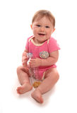 Baby girl playing with bottle filled with pasta. Cutout Stock Photography