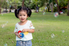 Baby girl playing bubble balloon Stock Photography