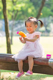 Baby girl playing bubble gun 2 Royalty Free Stock Photo