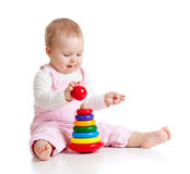 Baby girl playing with color developmental toy Royalty Free Stock Photos