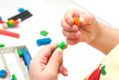 Baby girl playing with color play plasticine Stock Photo