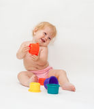 Baby girl playing colorful caps Stock Photo