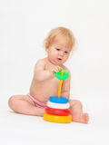 Baby girl playing colorful pyramid Stock Image