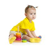 Baby girl playing with colorful pyramid isolated Stock Photos