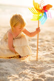 Baby girl playing with colorful windmill toy Royalty Free Stock Photography