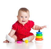 Baby girl playing with colourful toy on white Stock Image