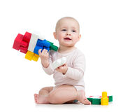 Baby girl playing with construction set over white background Royalty Free Stock Images