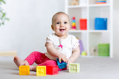 Baby girl playing cubes block toys Royalty Free Stock Photography