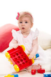 Baby girl playing with cubes Royalty Free Stock Photography