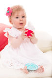 Baby girl  playing with cup tea toy Royalty Free Stock Images