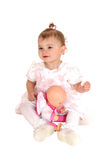 Baby girl playing with dolly. Stock Photography