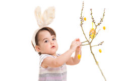 Baby girl playing with easter eggs Stock Photos