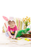 Baby girl playing with Easter eggs Royalty Free Stock Photos